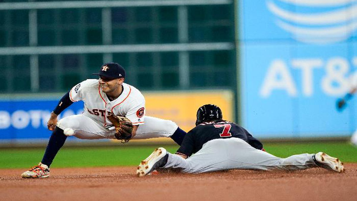 Washington Nationals' Trea Turner steals second with Houston Astros' Carlos Correa covering during the first inning of Game 1 of the baseball World Series Tuesday, Oct. 22, 2019, in Houston. (AP Photo/David J. Phillip)
