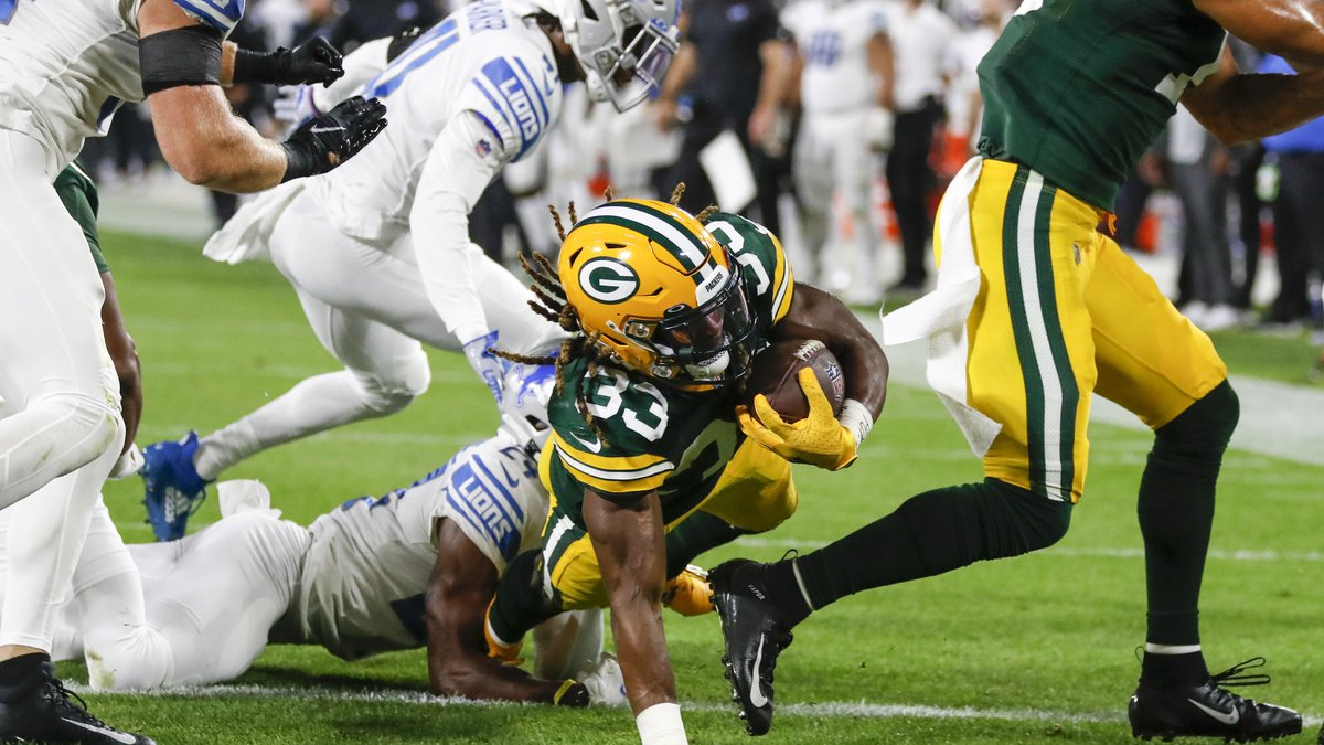 Green Bay Packers' Aaron Jones runs for a touchdown during the first half of an NFL football...
