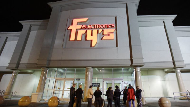 FILE- In this Oct. 21, 2009 file photo, a small crowd begins to gather outside a Fry's...
