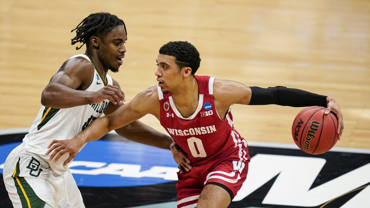 Wisconsin guard D'Mitrik Trice (0) drives on Baylor guard Davion Mitchell (45) in the first...