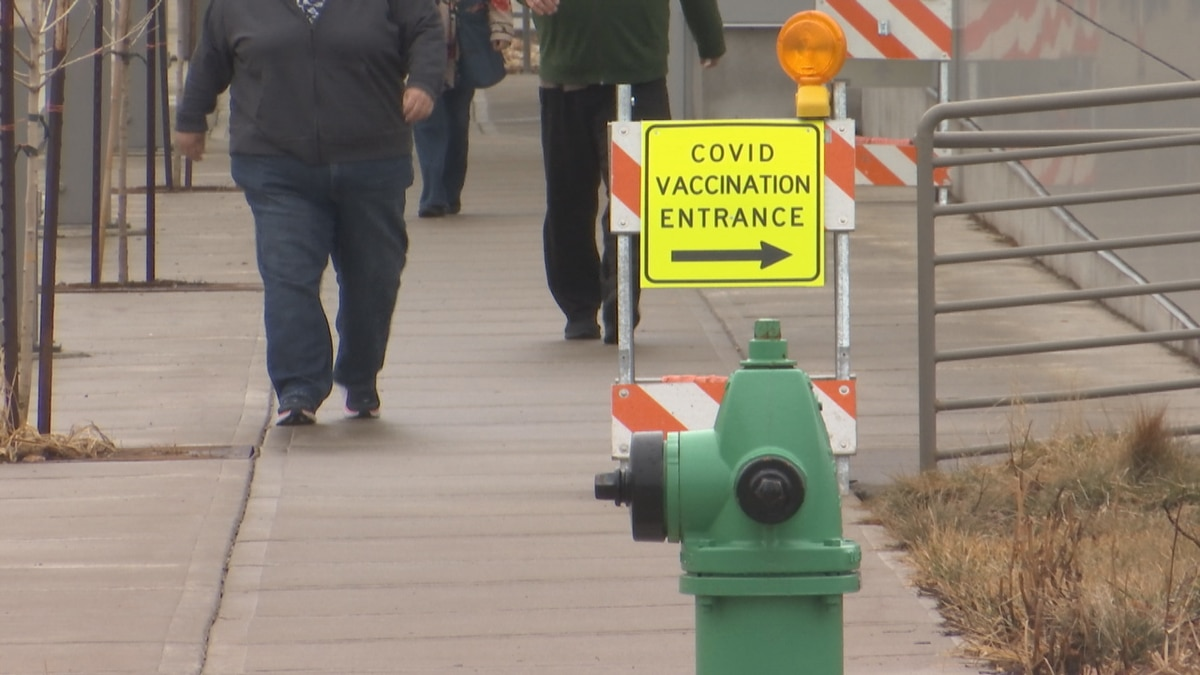 People heading to Fox Cities Exhibition Center for COVID-19 vaccinations.