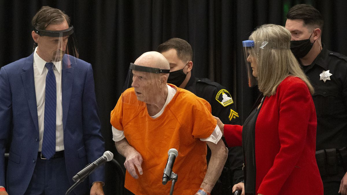 Joseph James DeAngelo, center, charged with being the Golden State Killer, is helped up by his attorney, Diane Howard, as Sacramento Superior Court Judge Michael Bowman enters the courtroom in Sacramento, Calif., Monday June 29, 2020. DeAngelo pleaded guilty to multiple counts of murder and other charges 40 years after a sadistic series of assaults and slayings in California. Due to the large numbers of people attending, the hearing was held at a ballroom at California State University, Sacramento to allow for social distancing.