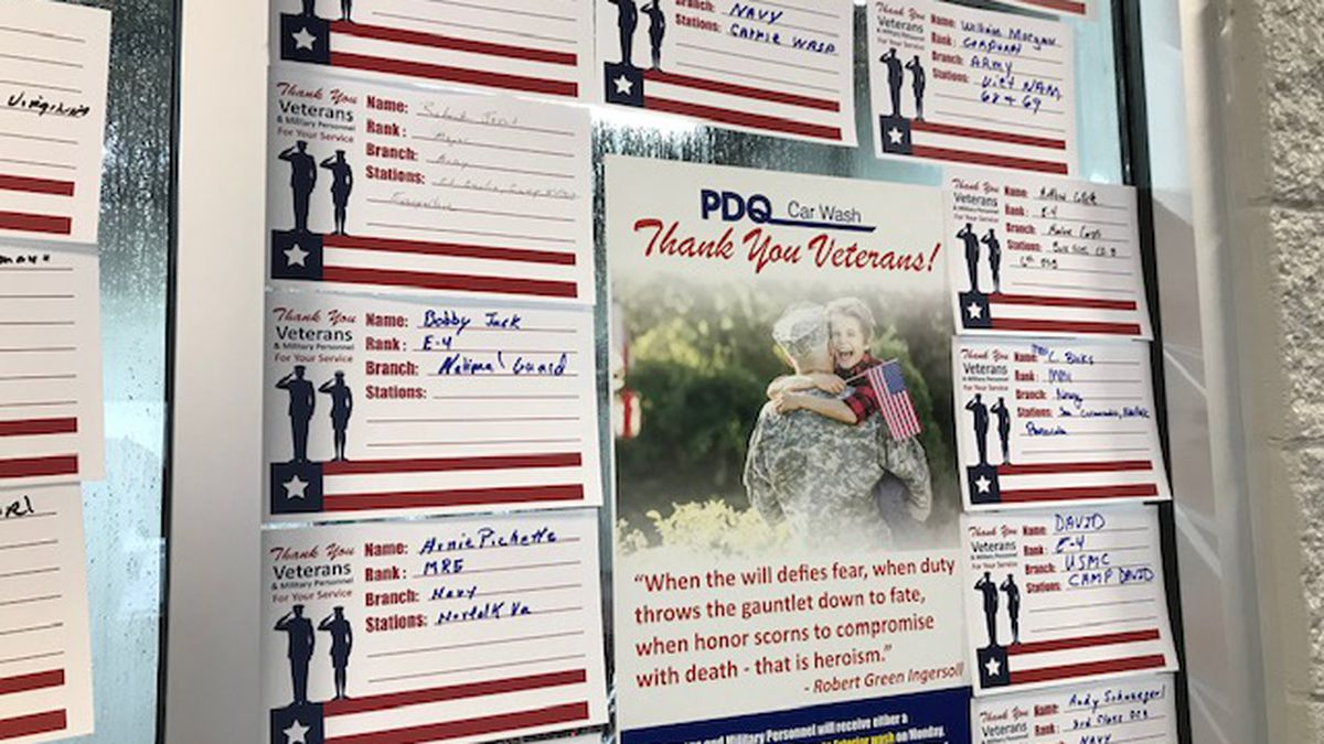 Veterans fill out cards with their name, branch and places they served and hang them on the...