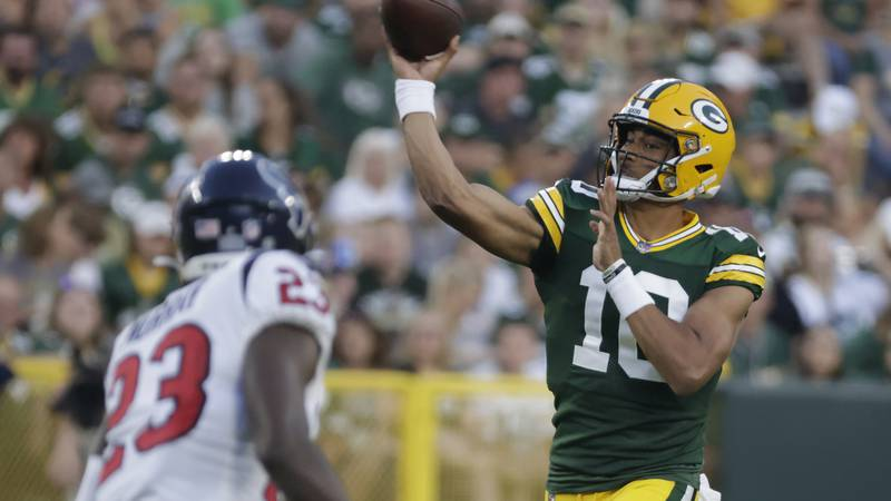 Green Bay Packers' Jordan Love throws during the first half of a preseason NFL football game...