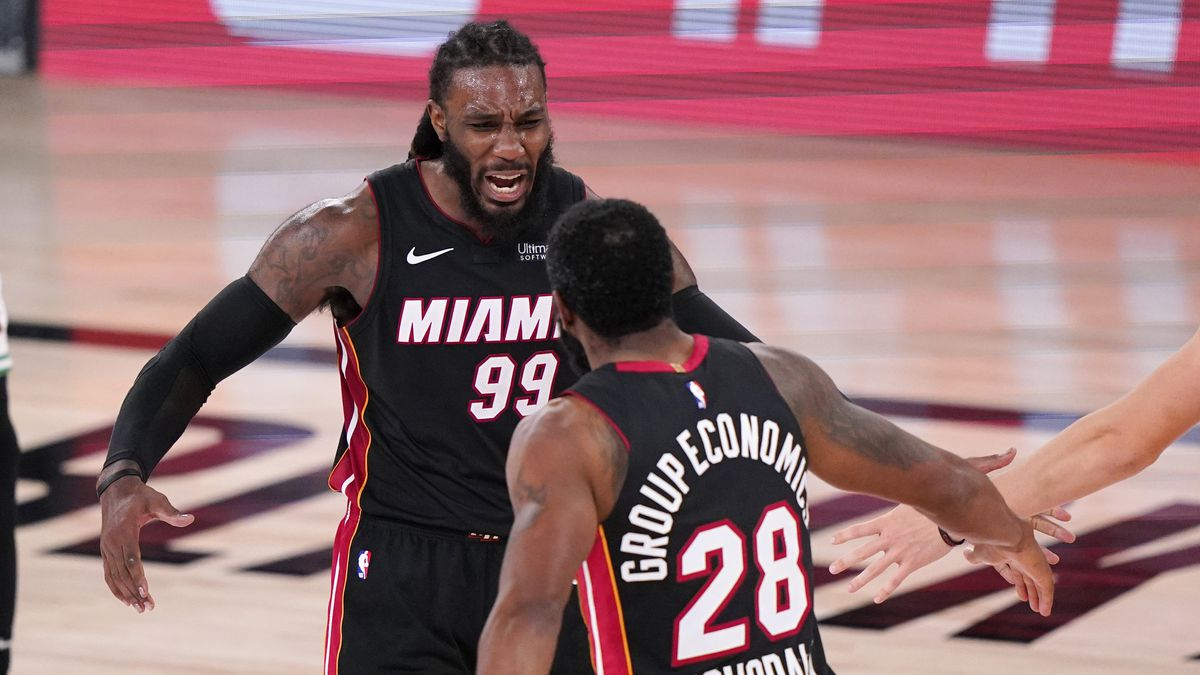 Miami Heat's Jae Crowder (99) and teammate Andre Iguodala (28) celebrate a basket during the...