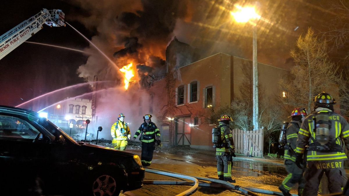 Firefighters battle a fire on Broadway in De Pere early in the morning of Wednesday, April 24, 2019. (WBAY photo)