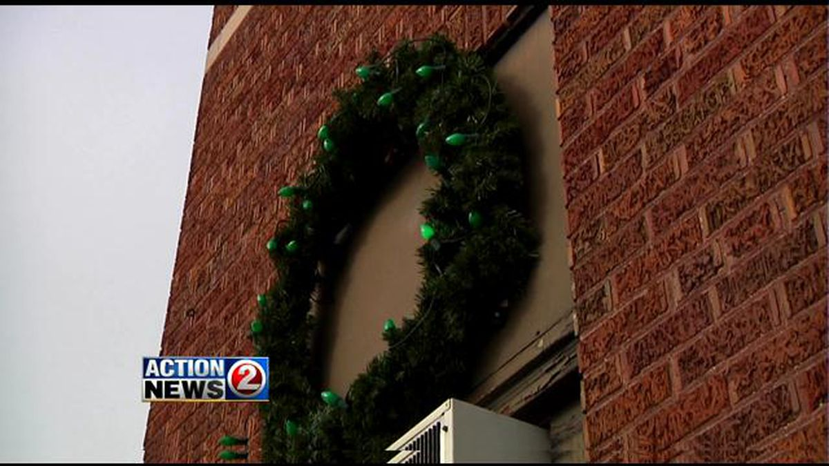 A wreath hangs over a Green Bay fire station as a fire safety reminder (WBAY photo)