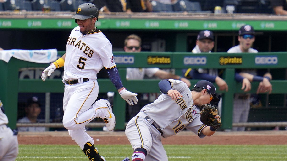 Pittsburgh Pirates' Michael Perez (5) reaches first safely as Milwaukee Brewers second baseman...