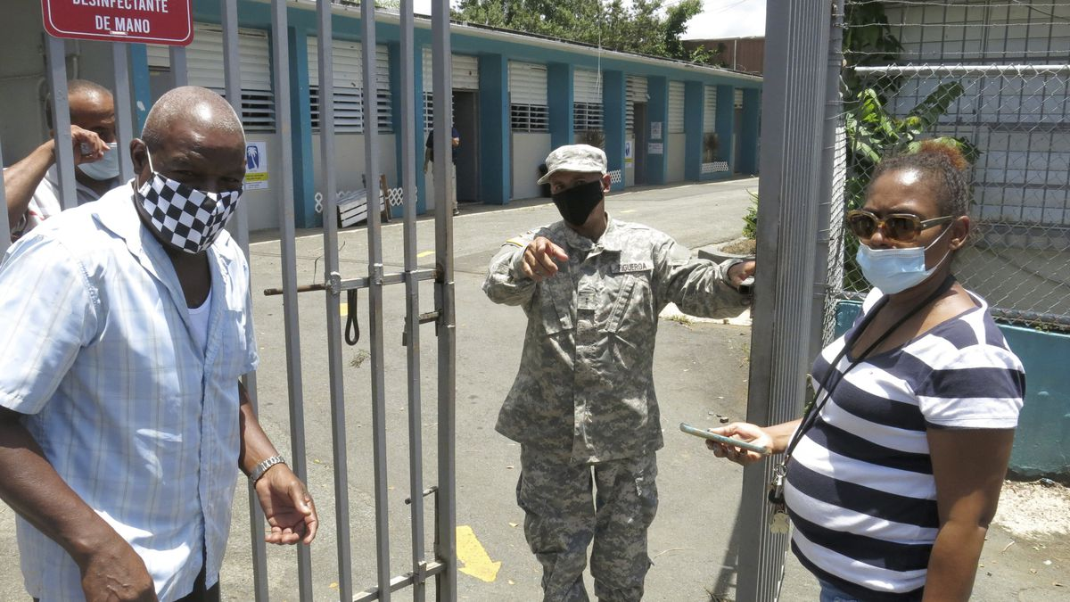 An official turns away two voters at a voting center lacking ballots in Carolina, Puerto Rico,...