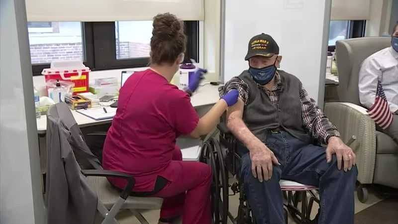 Melvin Rehkop, 102-year-old WWII veteran, receives the COVID-19 vaccine.