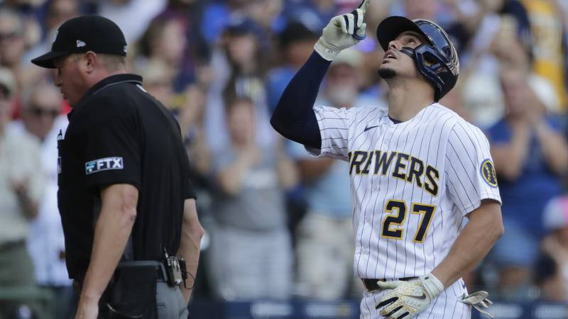 Milwaukee Brewers' Willy Adames, right, gestures after hitting a two-run home run during the...
