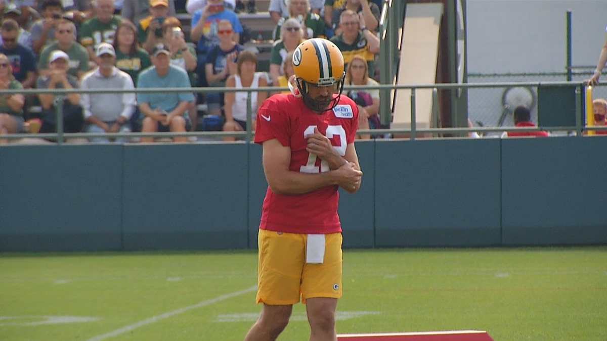 Packers quarterback Aaron Rodgers reacts after throwing a pass during Training Camp at Ray...
