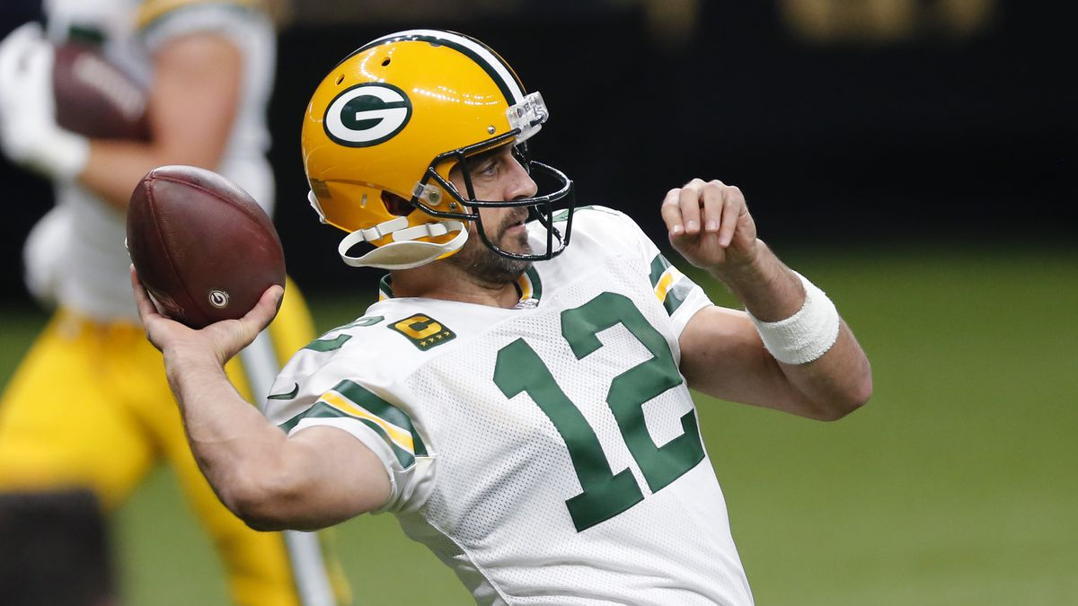 Green Bay Packers quarterback Aaron Rodgers (12) warms up before an NFL football game against...