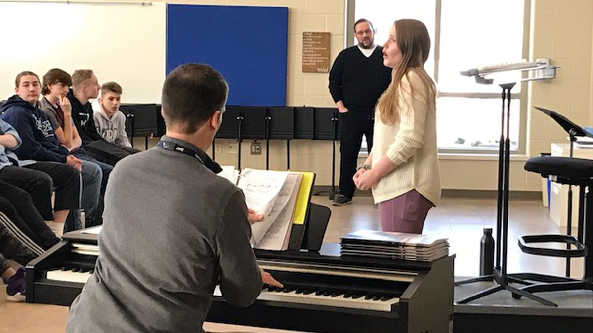 Opera singer Scott Ramsay works with Ella Fontecchio, Bay Port High School junior, to perfect her opera-singing skills.