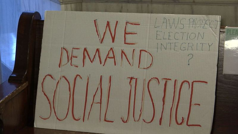 """Sign at today's press conference reads """"we demand social justice"""""""