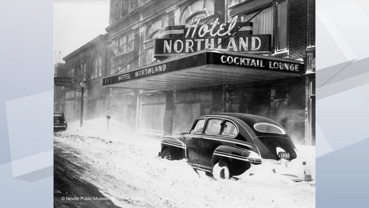 A car is snowed in outside the Hotel Northland in downtown Green Bay in this photo from the...