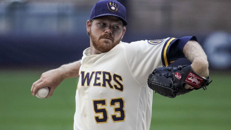 Milwaukee Brewers' Brandon Woodruff throws during a practice session Saturday, July 4, 2020, at...