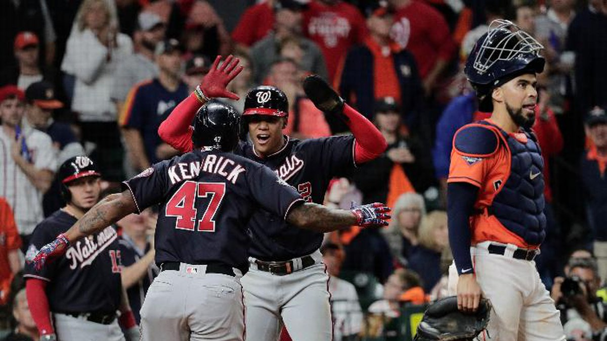 Washington Nationals' Howie Kendrick is congratulated by Juan Soto after hitting a two-run home...