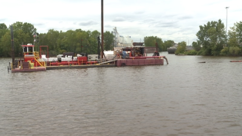 A barge dredges sediment from the Fox River in June 2020