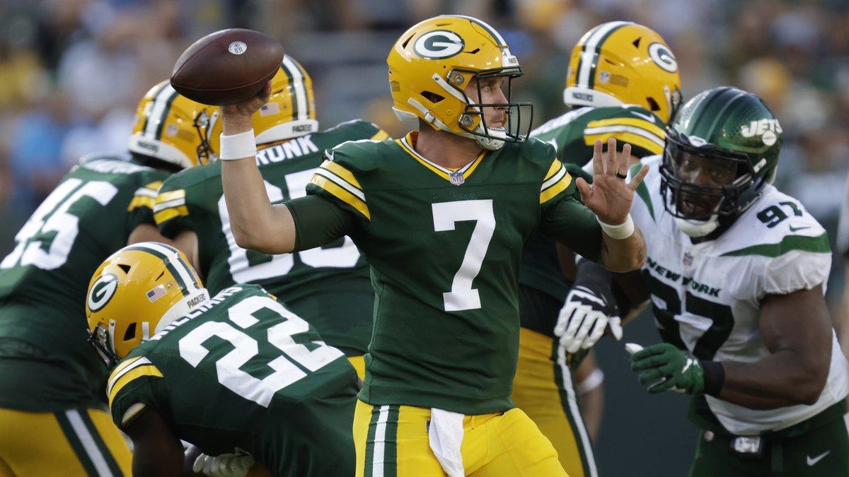 Green Bay Packers' Kurt Benkert throws during the second half of a preseason NFL football game...