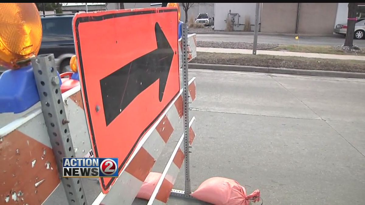 Detour sign on road barricade