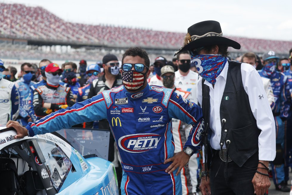 Team owner Richard Petty, right, stands with driver Bubba Wallace prior to the start of the...