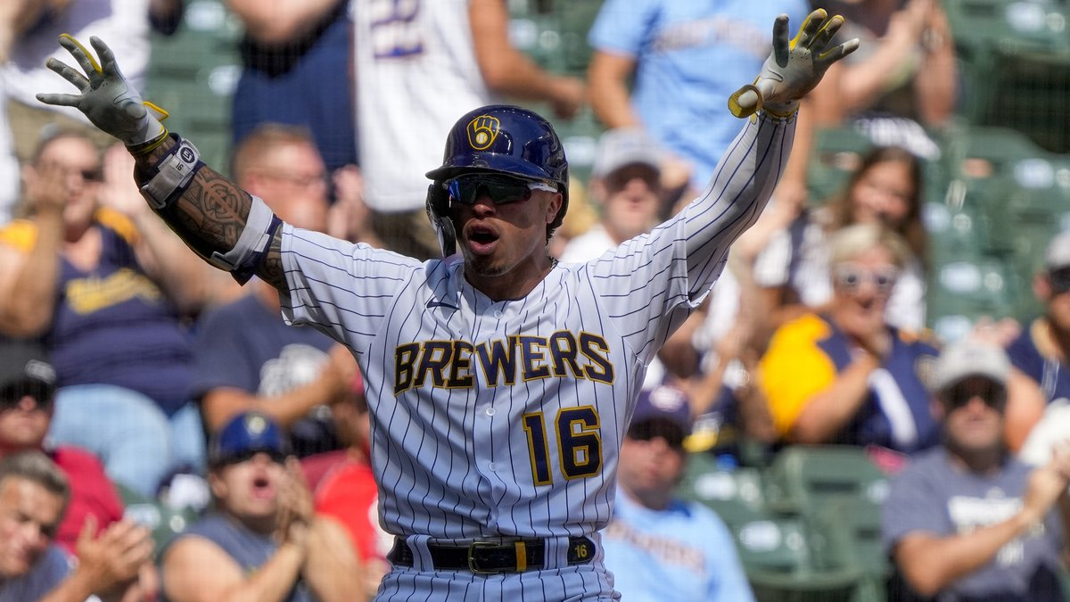 Milwaukee Brewers' Kolten Wong reacts after hitting a two-run scoring triple during the fourth...