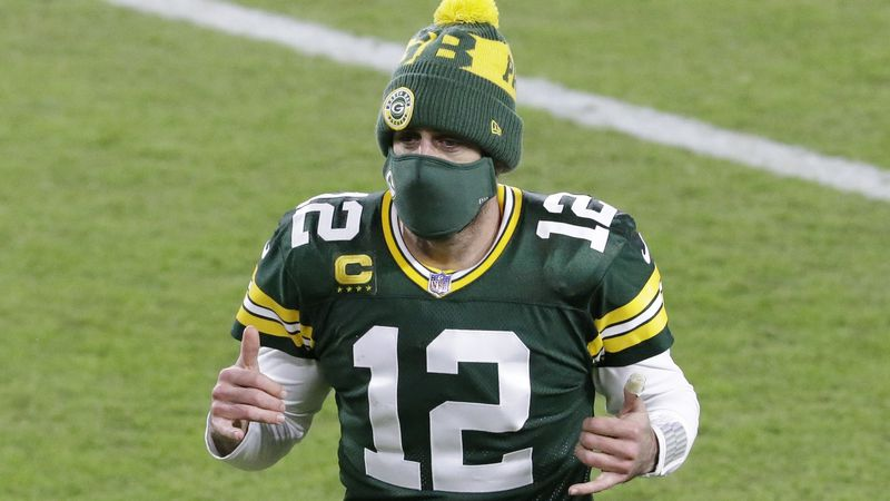 Green Bay Packers' Aaron Rodgers reacts as he runs off the field after an NFL football game...