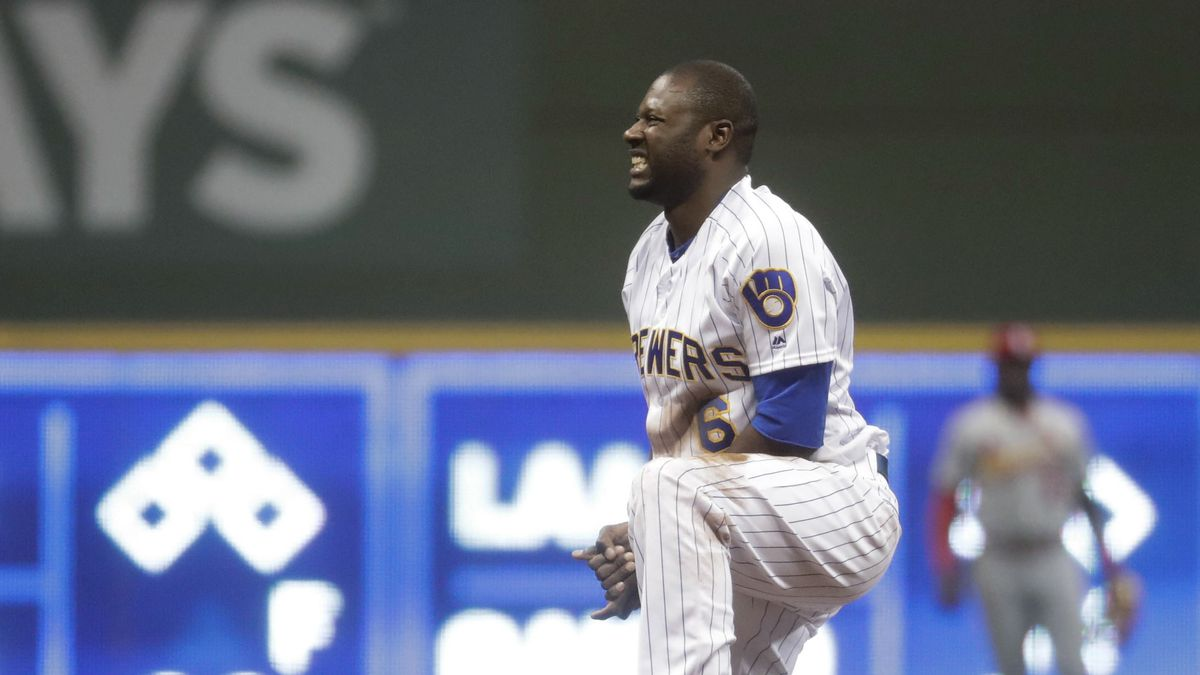 Milwaukee Brewers' Lorenzo Cain holds his hand after being caught stealing second during the...