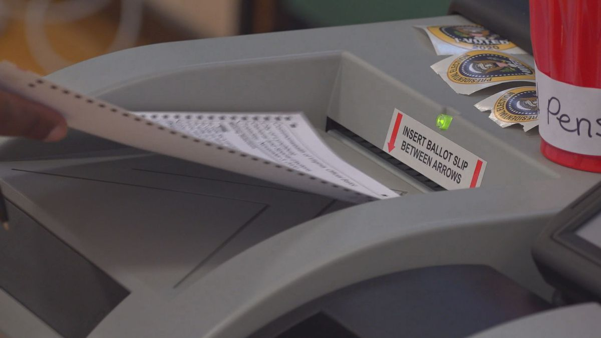 A ballot is put into the machine during voting in November.
