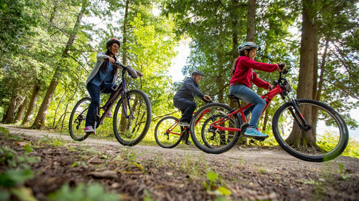 A family biking at Peninsula State Park in Door County where new park upgrades arrived this...