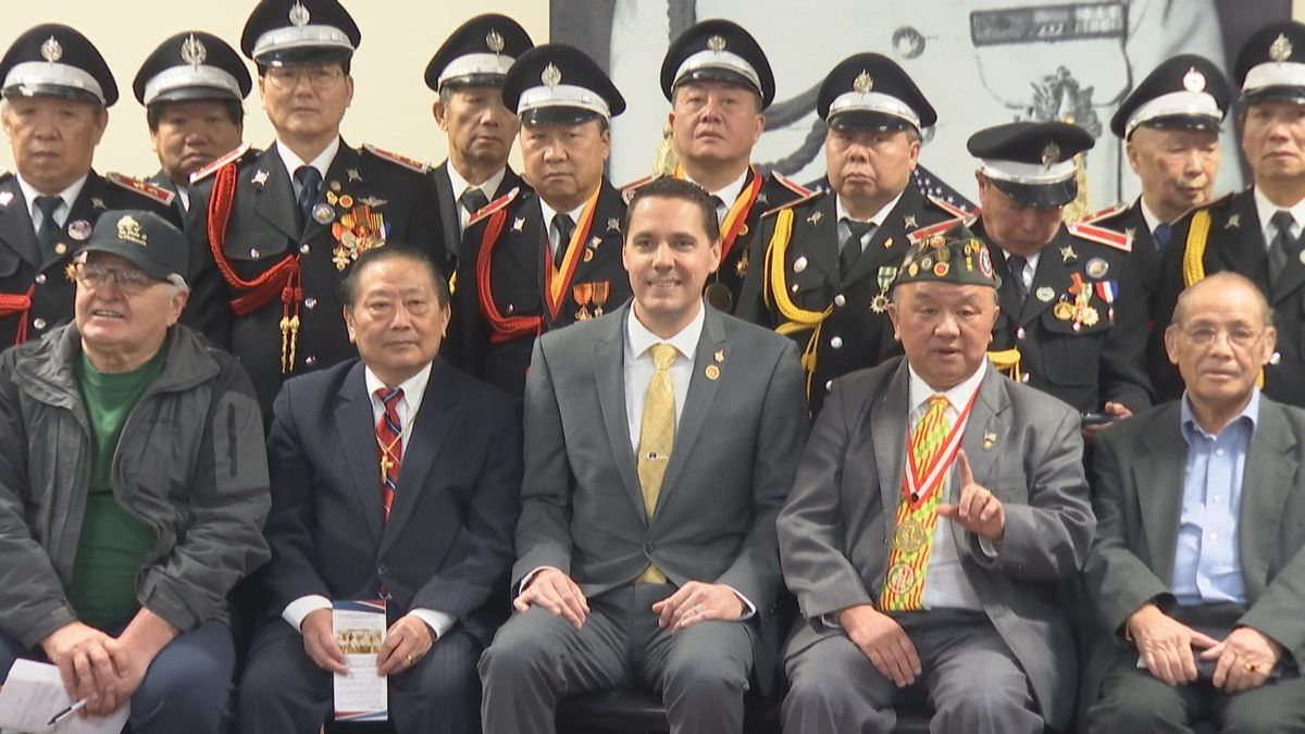 State Sen. Roger Roth (front row center) at an event honoring veterans at Long Cheng Marketplace in Appleton in January 2020. Roth supports a bill to create a Hmong-Lao Veterans Day in Wisconsin to honor their sacrifices (WBAY photo)