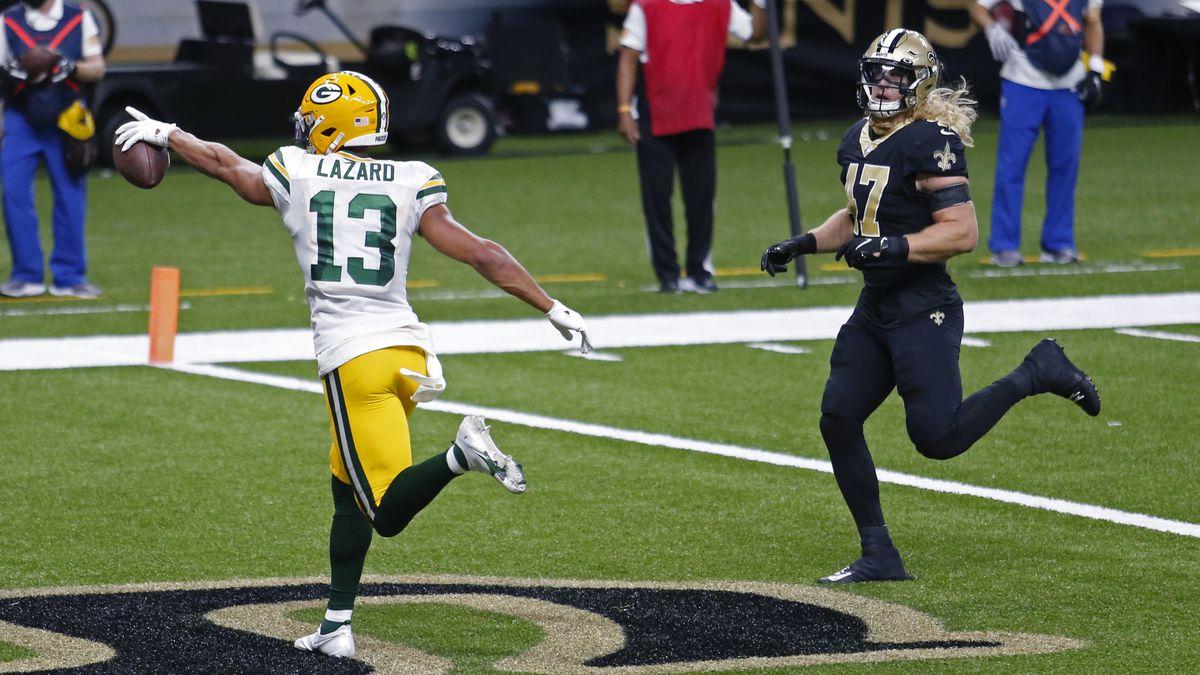 Green Bay Packers wide receiver Allen Lazard (13) gestures after a touchdown reception against...