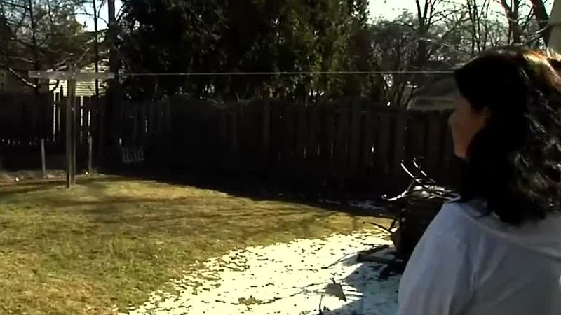 New homeowner Veronica Roskom looks at her backyard in Green Bay