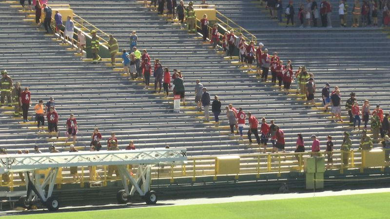 Hundreds of people climb stairs at Lambeau Field in 2018 to benefit families of fallen...