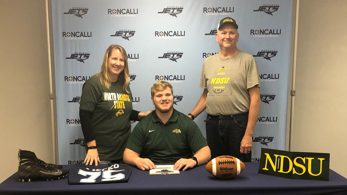 Roncalli senior OL/DL Trevor Fiecko signs his National Letter of Intent with North Dakota State...