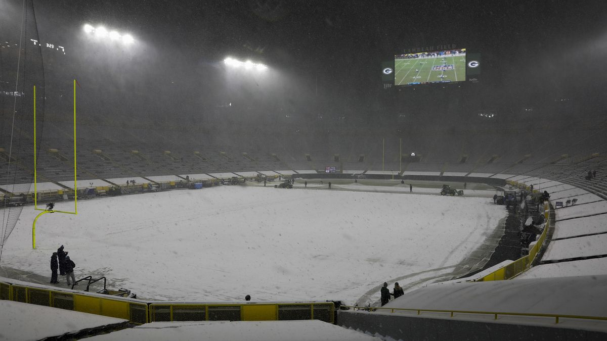 Snow falls before an NFL football game between the Green Bay Packers and the Tennessee Titans...