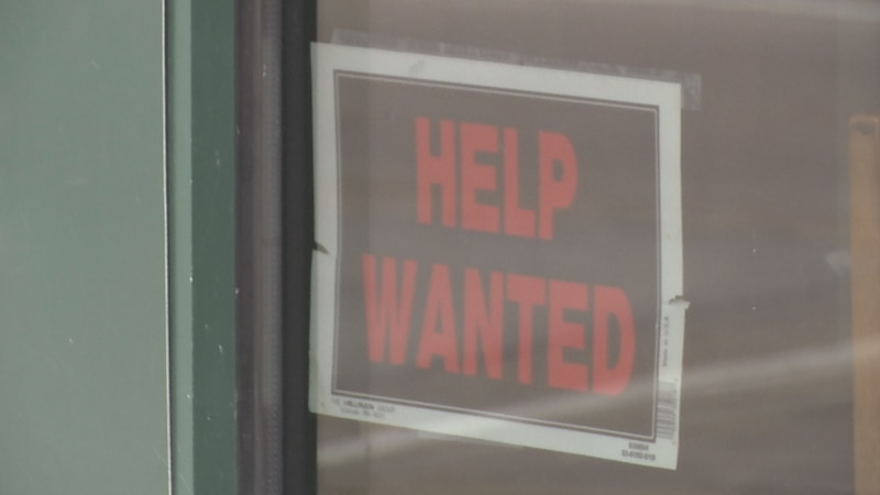 Help wanted sign outside restaurant.