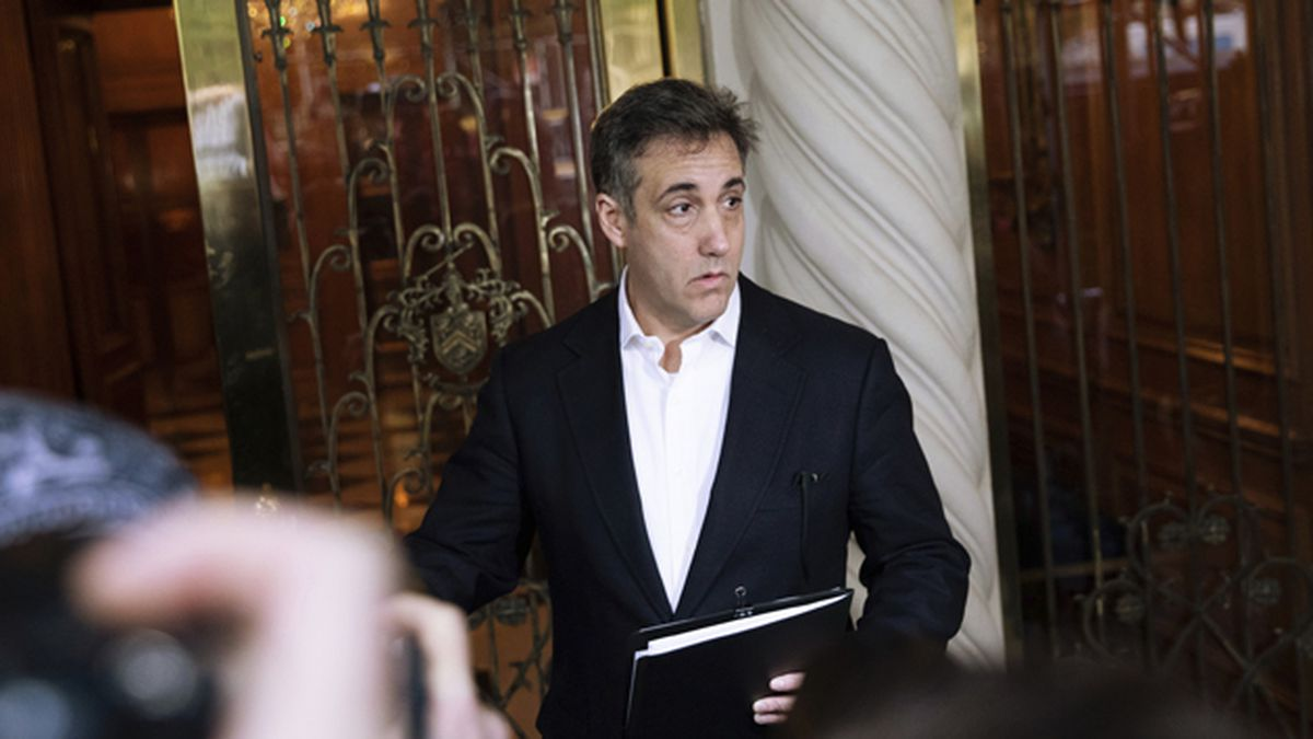 In this May 6, 2019 file photo, Michael Cohen, former attorney to President Donald Trump, holds a press conference outside his apartment building before departing to begin his prison term in New York. (AP Photo/Kevin Hagen, File)