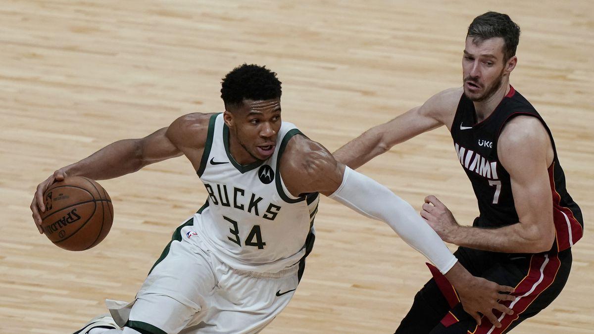Milwaukee Bucks forward Giannis Antetokounmpo (34) goes around Miami Heat guard Goran Dragic...