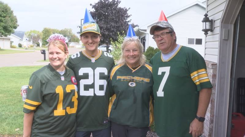 Emily Mauk poses for a picture with family, ahead of her first Packers game as a season ticket...