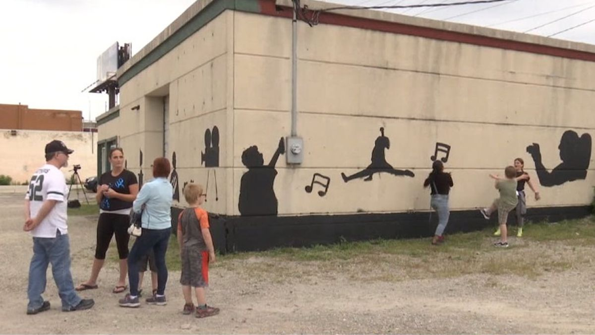 Young artists from the Boys & Girls Club of Greater Green Bay are painting a mural 'The Shadows' on a city building on S. Broadway (WBAY photos)