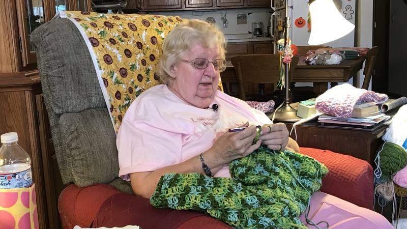 Marilyn Drake crochets a prayer shawl.