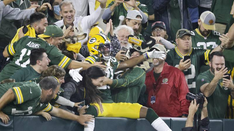 Green Bay Packers' Eric Stokes celebrates after intercepting a pass during the second half of...