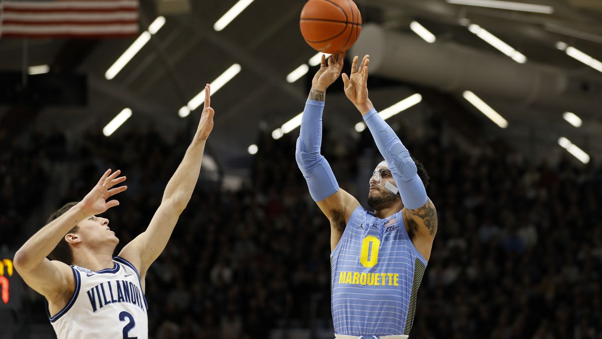 Marquette's Markus Howard (0) goes up for a shot against Villanova's Collin Gillespie (2) during the first half of an NCAA college basketball game Wednesday, Feb. 12, 2020, in Villanova, Pa. (AP Photo/Matt Slocum)