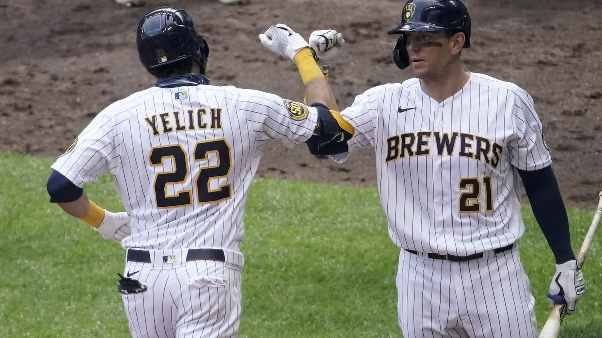 Milwaukee Brewers' Christian Yelich is congratulated by Logan Morrison (21) after hitting a home run during the seventh inning of a baseball game Sunday, Aug. 9, 2020, in Milwaukee. (AP Photo/Morry Gash)