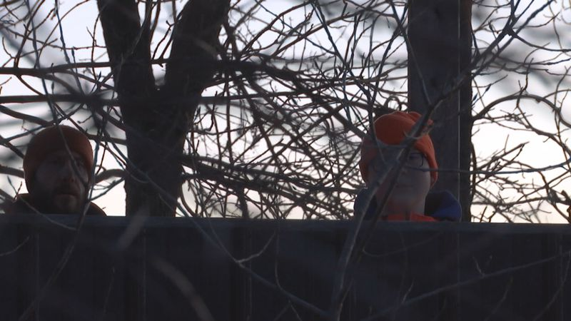 Matt and Harry Lauer are sitting in a deer stand in Outagamie County, Wisconsin early Saturday...