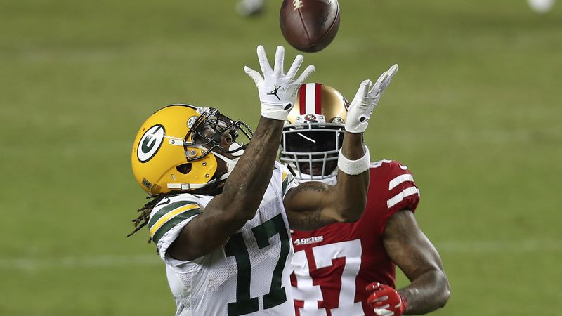 Green Bay Packers wide receiver Davante Adams (17) catches a pass in front of San Francisco...