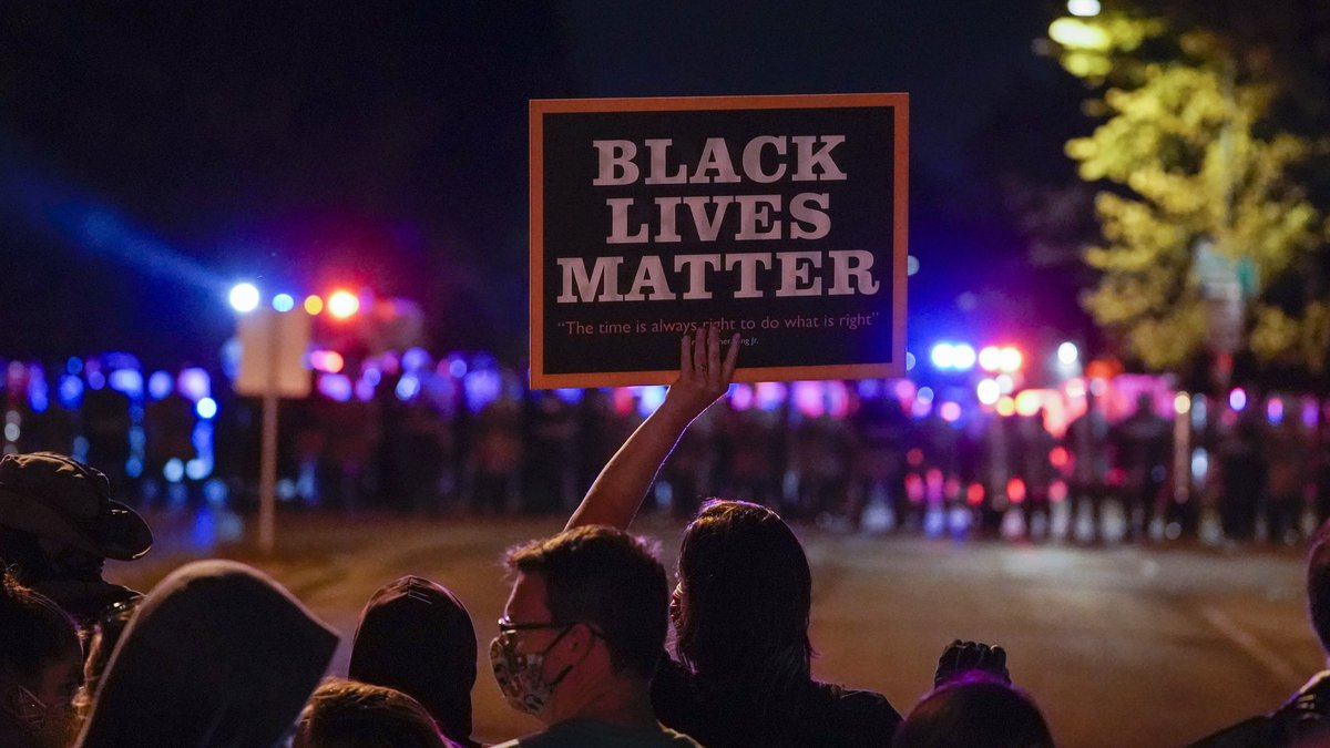 FILE - In this Oct. 2020, file photo, protesters and police line up in Wauwatosa, Wis., in the...