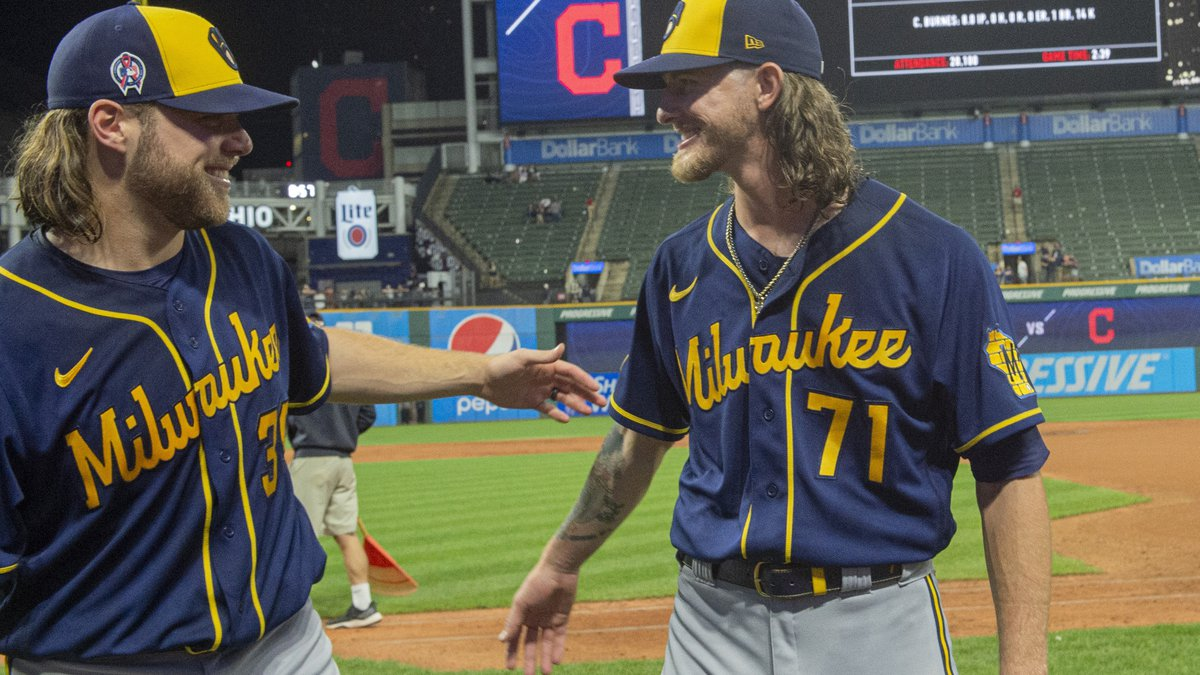 Milwaukee Brewers starter Corbin Burnes, left, and reliever Josh Hader celebrate after pitching...